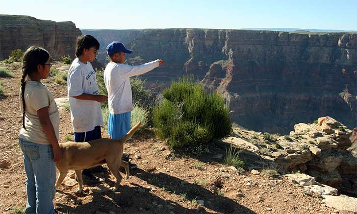 Navajo children offer corn pollen at The Confluence.